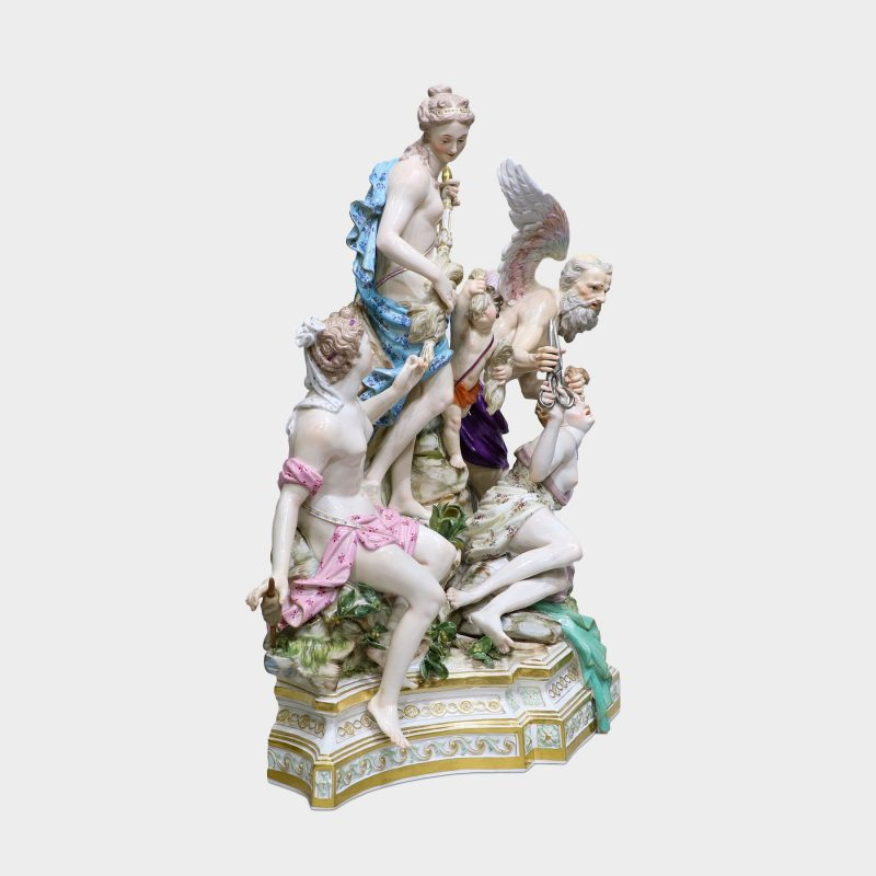 side view of Meissen porcelain group modeled with five figures standing upon rocky stepped trapezoidal gilt-enriched base